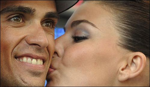 Astana rider and race leader Alberto Contador of Spain is kissed on the podium after the 17th stage of the Tour of Spain between Zamora and Valladolid September 17, 2008.