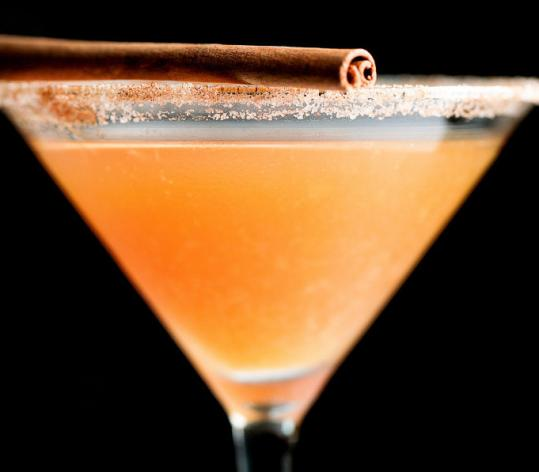 A Martini de Cidre at Aquitaine is made with spiced rum, orange juice, and sparkling apple cider.