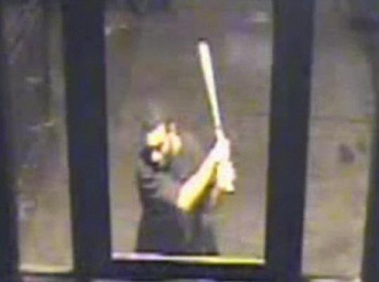 In this image from a surveillance video, a man is attacking Pelagio de la Cruz of Lynn in front of a Bronx, N.Y., building.
