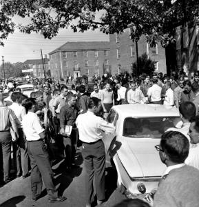 In this Oct. 2, 1962 photo, students crowded the car carrying James Meredith to the University of Mississippi campus in Oxford. He had to be escorted by the National Guard and US marshals.