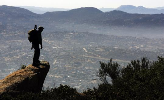 US Border Patrol Agent Brandon Longaker stood overlooking Tecate, Mexico, which lies 40 miles east of Tijuana. Tecate has been a smuggling point in the cross-border drug trade.
