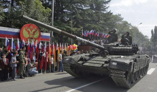 Thumbing its nose at Georgia and the United States, South Ossetia rolled yesterday what Russian media said were captured American-made jeeps and Georgian tanks through the streets of its capital, Tskhinvali, in an Independence Day military parade.