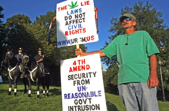 As two mounted police officers stood by, Michael Dee of Maine took a stance on drug laws yesterday on Boston Common.