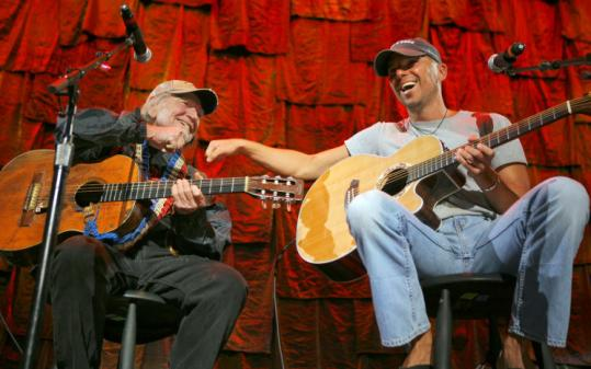 Willie Nelson (left) and Kenny Chesney on stage Saturday.