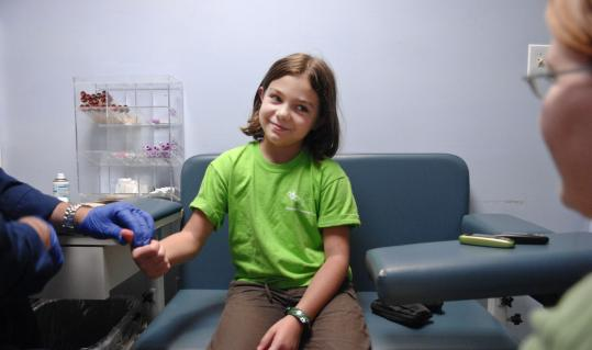 Ashley Truver, 9, of Bedford, N.H., at the Joslin Diabetes Center, which expects to lose $25,000 from Lehman Brothers.