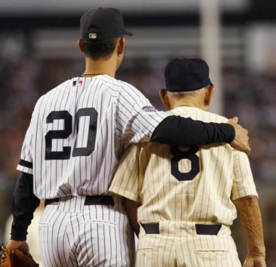 Jorge Posada (left) and Yogi Berra catch the proceedings before the final game was played at Yankee Stadium