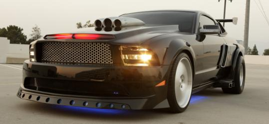 KITT is a hot-rod Mustang, voiced by Val Kilmer.