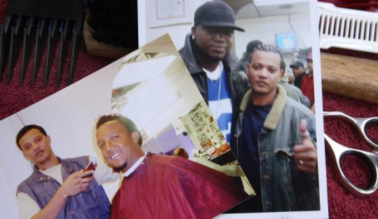 Photos of Felipe Gomez cutting Pedro Martinez's hair and posing with David Ortiz at the Fernandez Barbershop.