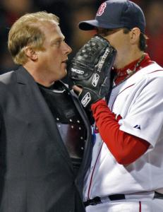 Josh Beckett talks privately with plate ump Bruce Dreckman after the second inning.