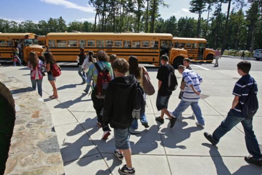 Buses line up at Whitman-Hanson High to pick up students.
