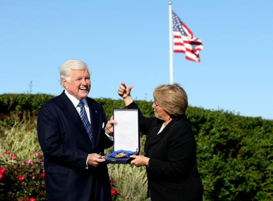 Chile's President Michelle Bachelet, with Senator Edward M. Kennedy, who says he was been busy after cancer treatments.