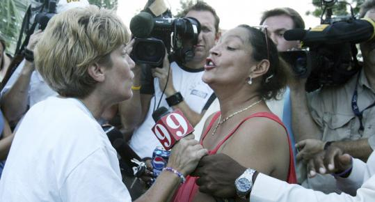 Cindy Anthony (left), grandmother of missing 3-year-old Caylee Anthony, confronted Kittie Gonzalez, who was among the protesters late last month in Orlando, Fla.