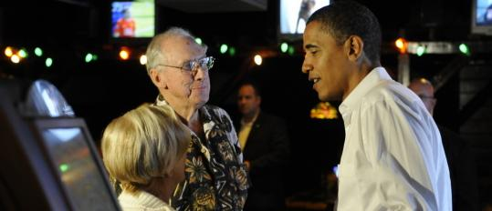 Barack Obama talked with residents at O'Keefe's Irish pub in Clearwater, Fla. He acknowledged yesterday the proposed $700 billion bailout of Wall Street may postpone some of his proposals.