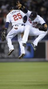 Alexi Casilla (left) and Carlos Gomez celebrate after the Twins' victory over Chicago.