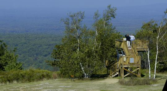 Jim Kellogg and son Jeremy take in the view from Mount Agamenticus, which extends to the White Mountains on a clear day.
