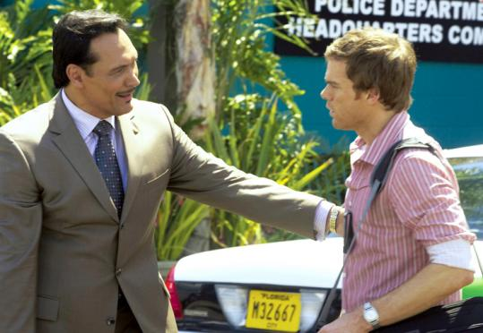 Michael C. Hall (above right, with Jimmy Smits) plays Dexter.