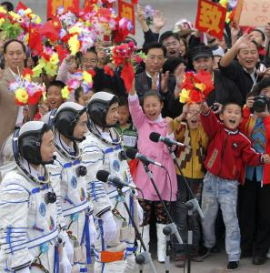 ASSOCIATED PRESS Astronauts (from left) Jing Haipeng, Zhai Zhigang, and Liu Boming before the launch of the Shenzhou 7 spacecraft yesterday at Jiuquan Satellite Launch Center in China's Gansu province.