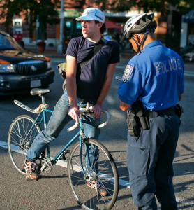 Mike McCaw, 29, of Somerville, received a warning from Officer Oswaldo Ortiz for riding through a red light.