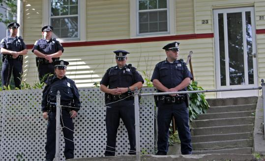 David L. Ryan/Globe StaffBoston police officers stood by when Raul and Ana Esquivel were ordered to leave their Roslindale home after the couple returned from court yesterday. The Esquivels said they couldn't persuade Deutsche Bank to consider alternatives to foreclosure.