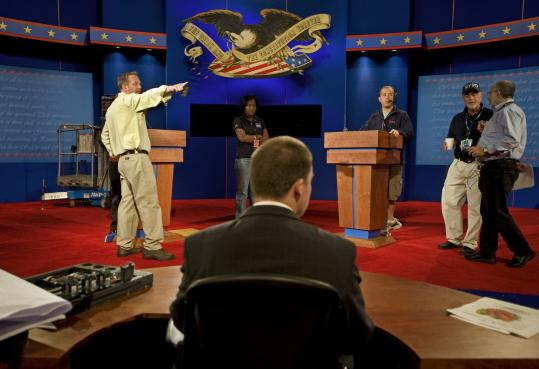 Stage and production crews made adjustments to the set for the first presidential debate, scheduled for tonight.