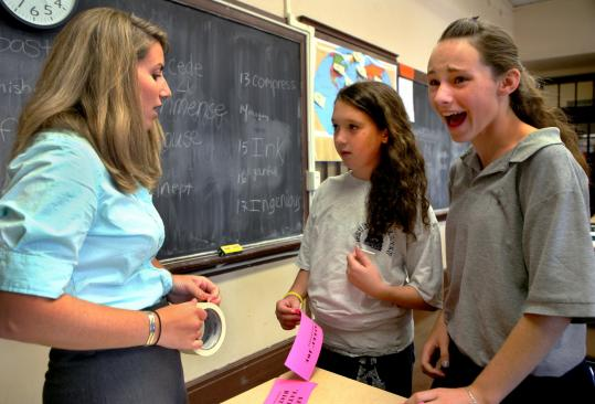 Second-year teacher Shannon Keating talked with seventh-graders Kerri Bemis (middle) and Chloe Fay at the Gate of Heaven School.