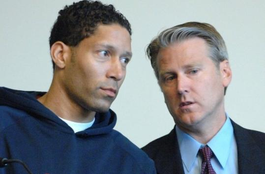 Ivan Latimore (left), with his attorney, Timothy Bradl, before his trial yesterday in Boston Municipal Court.