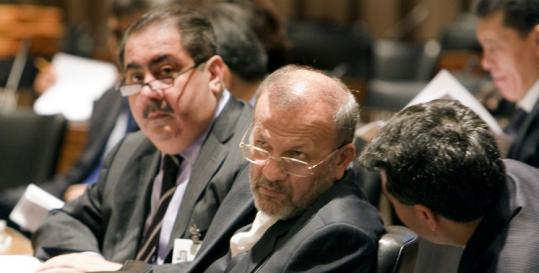 Iraqi Foreign Minister Hoshyar Zebari (left) and Iran's foreign minister, Manouchehr Mottaki (center), before a UN meeting Friday of Organization of Islamic States foreign ministers.