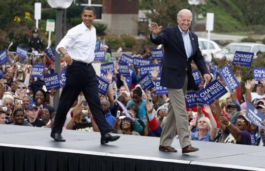 Barack Obama and Joe Biden arrive for a campaign rally yesterday in Greensboro, N.C.