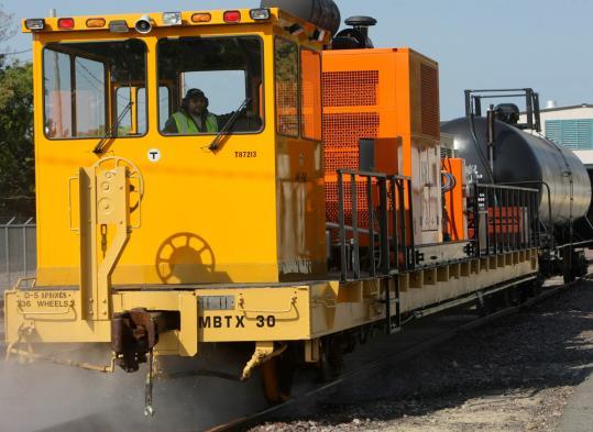 PHOTOS BY DAVID L. RYAN/GLOBE STAFFThe Mass Bay Commuter Railroad showed off its new, customized rail-cleaning machine at its West Cambridge Yard last week.