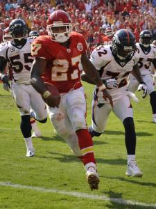 Broncos defenders scrambled all afternoon trying to stop the Chiefs' Larry Johnson, but they couldn't. Johnson rushed for 198 yards and two touchdowns.