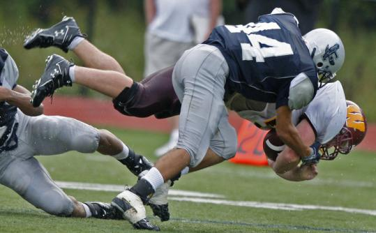 Andrew Lawson makes certain Weymouth's Dylan Colarusso is unable to break away during Framingham's victory.