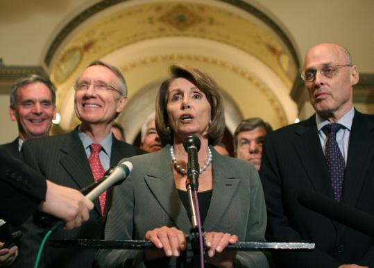 House Speaker Nancy Pelosi announced the deal on the financial bailout bill. With her (from left) are Senator Judd Gregg of New Hampshire, Senate majority leader Harry Reid, and Treasury Secretary Henry Paulson.