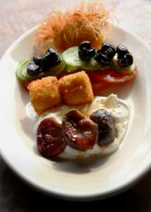 The Turkish breakfast (left) at Sofra is a soft-boiled in a crunchy nest of phyllo dough, beside fruit-topped yogurt and cheese croquettes.