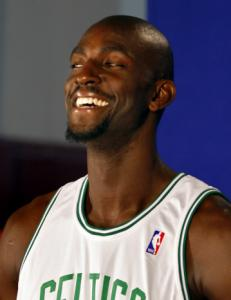 Kevin Garnett seems more than happy to get the Celtics' title defense under way.