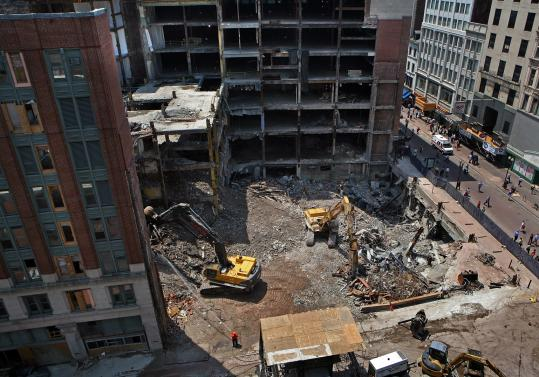 Clearing of much of the city block where Filene's operated for decades began in the spring to make way for a new high-rise, but the work stalled when the developers said they lacked sufficient funding - a problem that has now been solved.