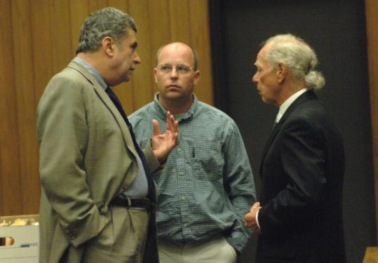 Haleigh Poutre's stepfather, Jason Strickland (center), spoke with lawyers Alan Black (left) and Richard Rubin yesterday.