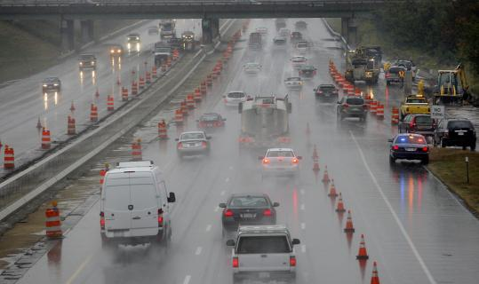 Suzanne Kreiter/Globe staffTraffic merged on the Mass. Pike yesterday as road work forced a lane closure in Westborough.