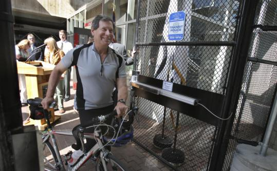 State Representative Jay Kaufmam, a Democrat from Lexington, was one of the first to lock up his bike at the new bike cages at Alewife Station. A press conference was held Sept. 18 to bring attention to the additional, secure racks.
