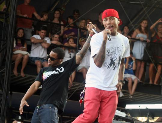 N.E.R.D.'s Pharrell Williams (right, with Shay Haley in Austin, Texas, last week) breezed through familiar songs at the Orpheum.