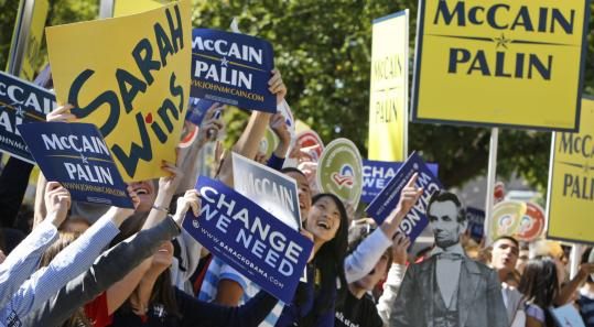 Students at Washington University (above, below) demonstrated outside the site of the debate between Democrat Joe Biden and Republican Sarah Palin.