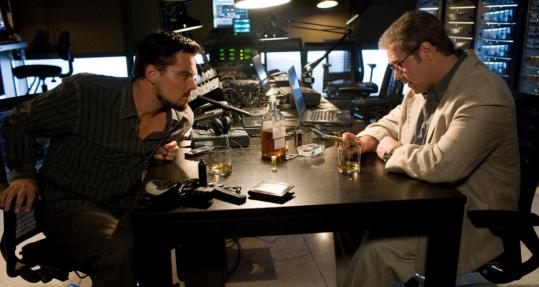 In ''Body of Lies'' Leonardo DiCaprio and Russell Crowe sit with EMC gear.