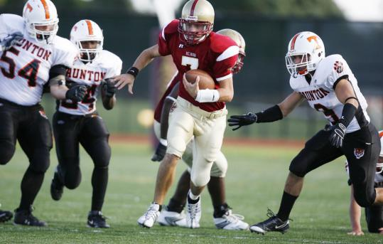 Quarterback Bill Kiley had a big day for BC High, passing for one TD and running for two more.