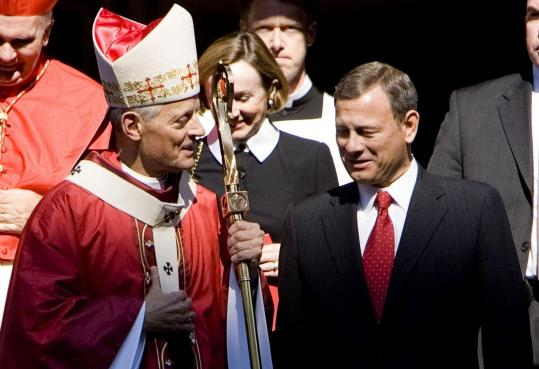 Archbishop of Washington Donald Wuerl walked with Chief Justice John Roberts after the celebration of the annual Red Mass in St. Matthew Cathedral in Washington yesterday. The Mass commemorates the beginning of a new term of the Supreme Court.