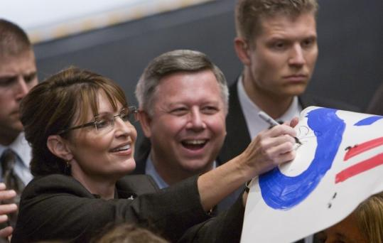 NATI HARNIK/ASSOCIATED PRESSThe GOP's emphasis on character started Saturday when Sarah Palin accused Obama of ''palling around with terrorists.'' She greeted supporters yesterday after a rally in Omaha.