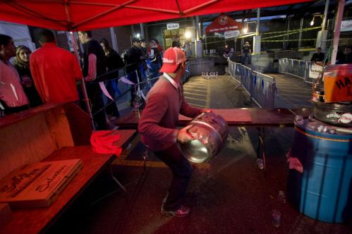 Disregarding the rules stating a player must throw his keg under the table, Brian Mason heaved his keg down the alley during a game of keg bowling. More info on the Harpoon Brewery SUBMIT Your nightlife photos! TALK What scene should we visit next?