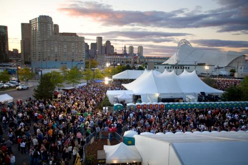 Hundreds of beer lovers celebrated the arrival of fall at Harpoon Brewery's 19th annual Octoberfest during the weekend. Revelers sipped Harpoon brews, snacked on German food, competed in keg bowling contests, and chicken-danced into the night. Pictured: The sunset over South Boston and the crowds at Octoberfest.