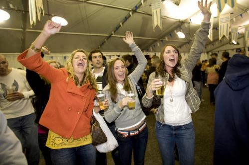 From left, Boston College students Kelly Skrodzki, Liz Dean, and Erin White cheered on a beer-drinking tuba player during Octoberfest. 'The crowd is much younger and there is less lederhosen,' Skrodzki said, comparing Harpoon's party to an Oktoberfest she witnessed in Munich. More info on the Harpoon Brewery SUBMIT Your nightlife photos! TALK What scene should we visit next?
