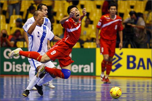 See more photography at Boston.com/photos China's Zhang Xiao, 9, is fouled by Guatemala's Rafael Ortiz, left, during their FIFA Futsal World Cup 2008 match in Brasilia, Tuesday, Oct. 7, 2008.
