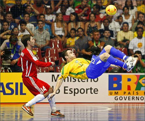 See more photography at Boston.com/photos The FIFA Futsal World Cup Brazil 2008 is in full swing with 20 teams from around the world competing in the five-man version of soccer played indoors on a basketball-sized court in Brasilia and Rio de Janeiro, Brazil. Alessandro Falcao (R) of Brazil fights for the ball with Damir Khamadiev of Russia during their FIFA Futsal World Cup qualifying soccer match at the Gimnasio Nilson Nelson in Brasilia October 4, 2008.