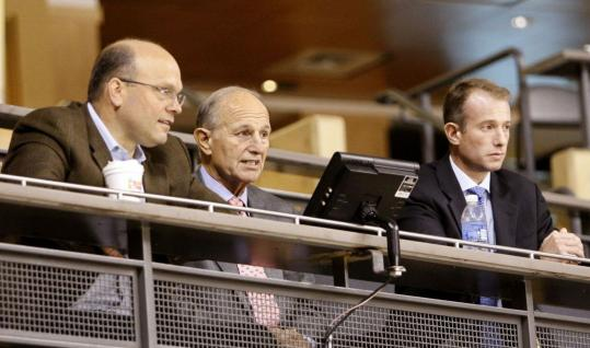 Bruins owner Jeremy Jacobs (center), flanked by son Charlie, said he likes how Peter Chiarelli (left) does business.